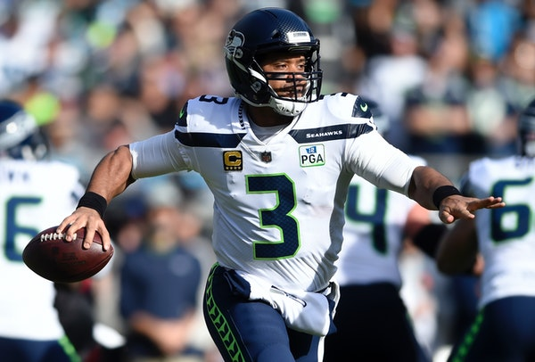 Russell Wilson looks to pass against the Panthers last month.