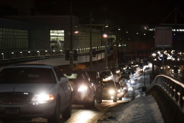 Cars line up to enter the departure area of Minneapolis-St. Paul Airport's Terminal 1.
