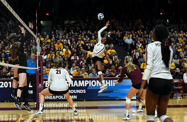 Gophers right side hitter Stephanie Samedy (10) spiked the ball against Bryant during last weekend's opening round.