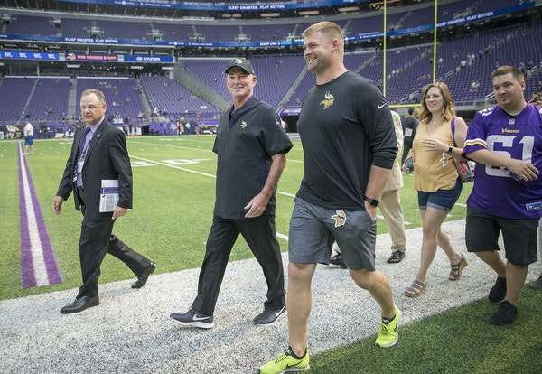 Vikings coach Mike Zimmer walked out during a preseason game with retired lineman Joe Berger in August.