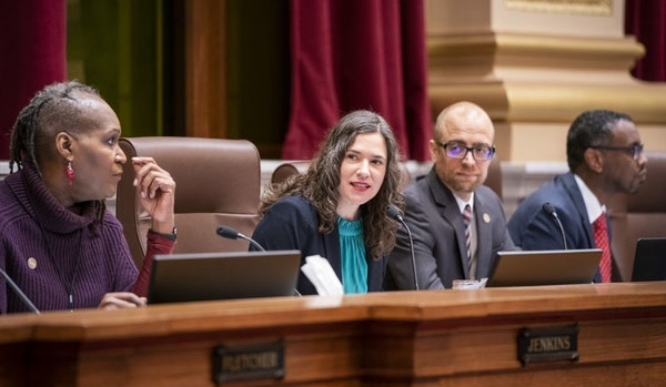 Minneapolis City Council President Lisa Bender, center, and other council members in December.