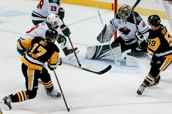 Pittsburgh's Bryan Rust (17) scored his second goal of the night on Wild goaltender Devan Dubnyk during the third period