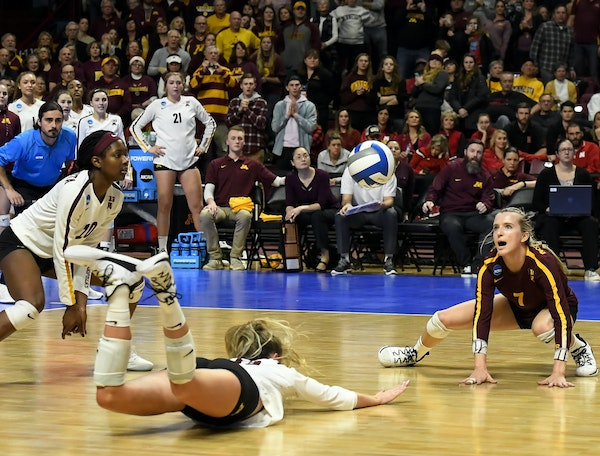Minnesota setter Samantha Seliger-Swenson (13) tried to keep the ball off the ground for set point in the second set. The Gophers won the point but it