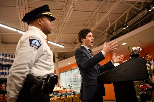 Minneapolis Police Chief Medaria Arradondo stood beside Minneapolis Mayor Jacob Frey as Frey addressed the media bout police-community relations at No