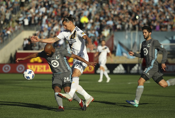 Los Angeles Galaxy forward Zlatan Ibrahimovic was shadowed by United midfielder Collen Warner (26) during a game Oct. 21.