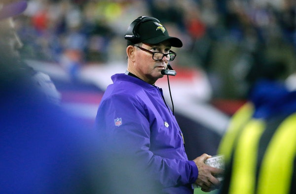 Vikings head coach Mike Zimmer watches from the sideline during the first half against the New England Patriots