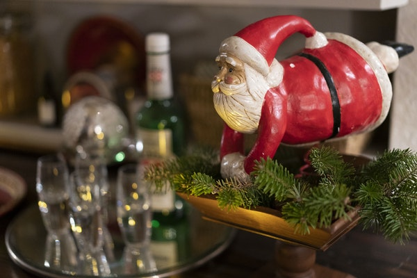 In designer Liz Knutson's home, a Santa figure watches over the basement bar.
