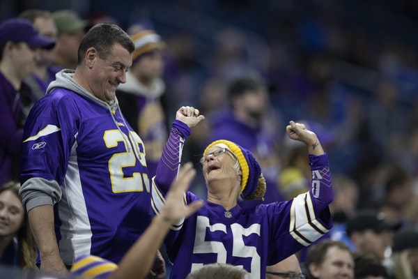 Vikings fans celebrated late in the fourth quarter at Ford Field in Detroit on Sunday.