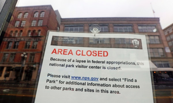The tiny Klondike Gold Rush National Historical Park in Seattle's historic Pioneer Square neighborhood is posted with a closed sign as part of the fed