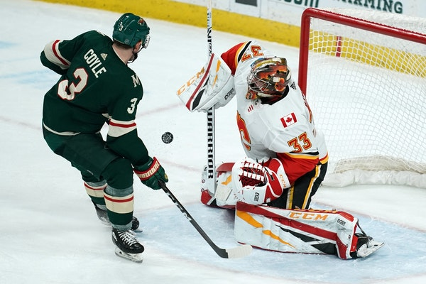 Wild center Charlie Coyle shot wide on Calgary goaltender David Rittich earlier this month.