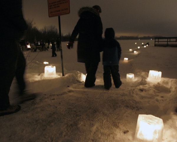 Visitors at Fort Snelling State Park walked along candlelit paths during a past New Year's Eve celebration.