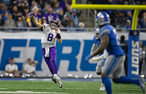Minnesota Vikings quarterback Kirk Cousins (8) threw a complete pass to Minnesota Vikings wide receiver Adam Thielen (19) in the second quarter at For