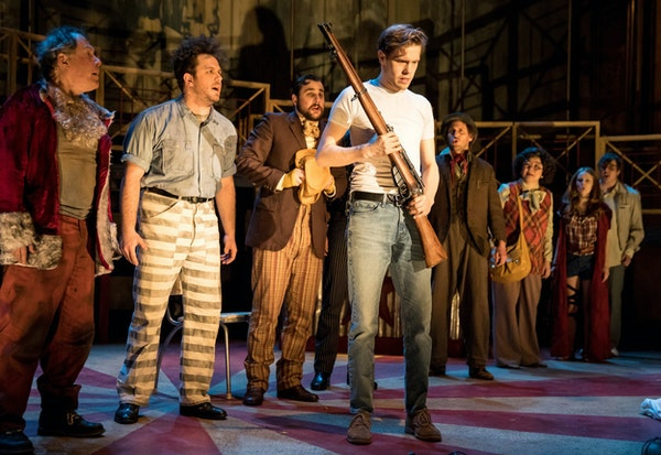 """Tyler Michaels as Lee Harvey Oswald, foreground, in """"Assassins"""" by Theater Latté Da."""