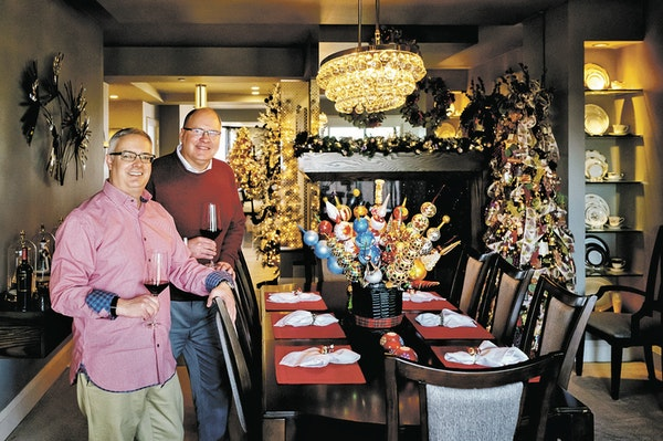 Matt Kiser and Chris Nichol at their dining table, with its centerpiece of finial ornaments and trees in the background, of course.