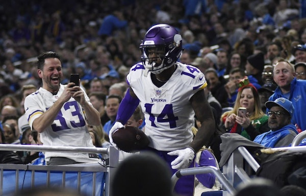 Minnesota Vikings wide receiver Stefon Diggs (14) leaves the stands after scoring a touchdown during the first half of an NFL football game against th