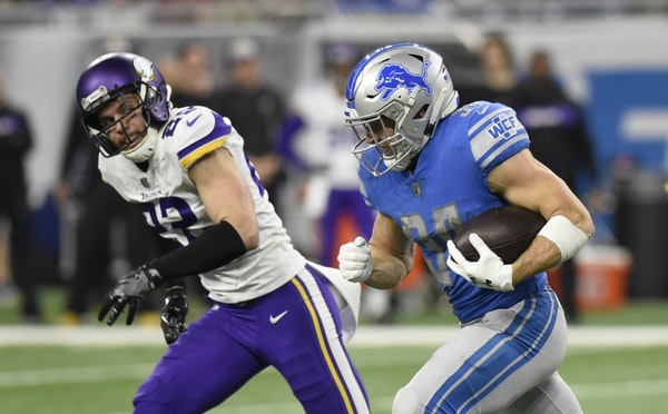 Minnesota Vikings free safety Harrison Smith (22) chases Detroit Lions running back Zach Zenner (34) during the first half of an NFL football game, Su