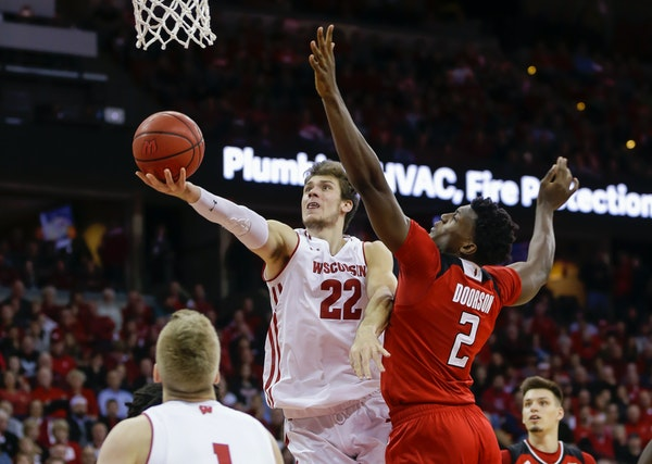 Wisconsin's Ethan Happ (22) shoots against Rutgers' Shaquille Doorson (2) during the second half of an NCAA college basketball game Monday, Dec. 3, 20