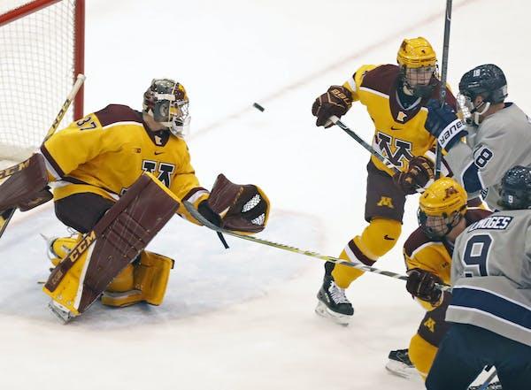 Gophers goalie Eric Schierhorn makes a save against Penn State last season.