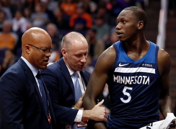 Wolves center Gorgui Dieng left the court after being ejected following an altercation with the Suns' Devin Booker during the second half Tuesday.