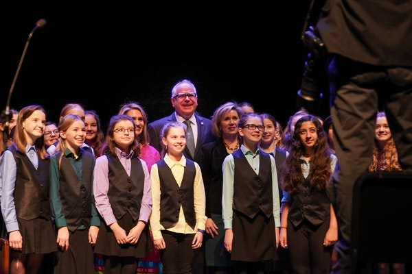 Tim Walz posed for a photo with the Minneapolis Youth Chorus before his swearing in ceremony. On the left is Lt. Gov.-elect Peggy Flanagan. On the rig