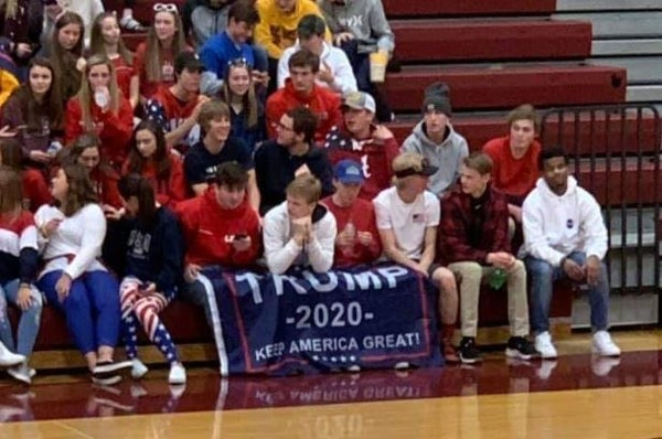 Twin Cities school superintendent reviewing display of Trump 2020 flag at basketball game