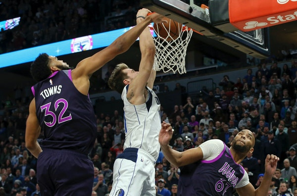 Dallas rookie guard Luka Doncic dunked past Wolves star Karl-Anthony Towns in the second half Friday.