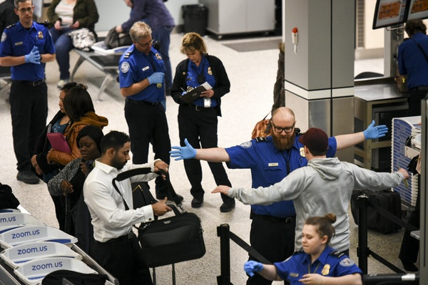 TSA employees worked without pay Tuesday at Terminal 1 at Minneapolis-St. Paul International Airport.