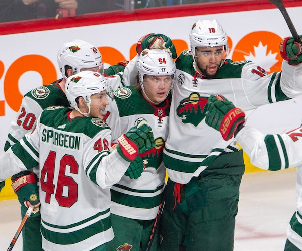 Wild right winger Mikael Granlund (64) celebrated the game's lone goal against the Canadiens, surrounded by teammates Jared Spurgeon (46), Ryan Suter