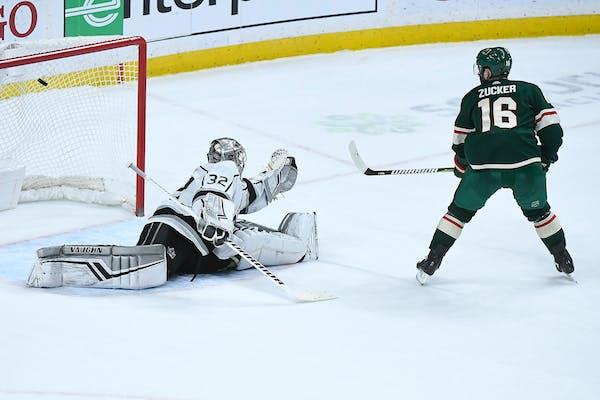 Jason Zucker scores the game-winning goal in a shootout against Los Angeles Kings goaltender Jonathan Quick at Xcel Energy Center