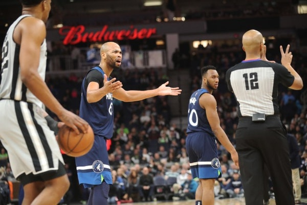 Taj Gibson (67) and Josh Okogie (20) couldn't believe a foul call Friday night during the Wolves' loss to the Spurs.