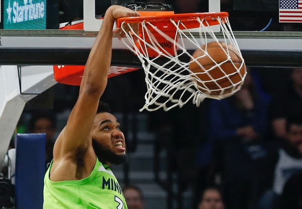 Timberwolves star Karl-Anthony Towns dunked for two of his 27 points vs. New Orleans on Saturday.