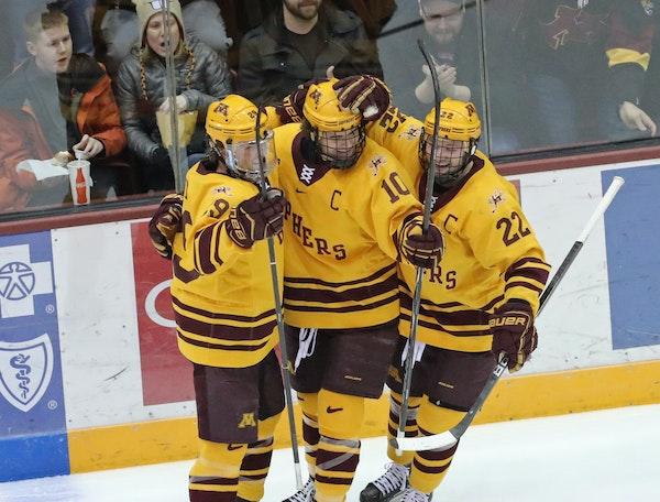 Gophers left wing Brent Gates Jr. (10) celebrated with teammates Tyler Nanne (29) and Tyler Sheehy (22) after scoring a goal in the second period.