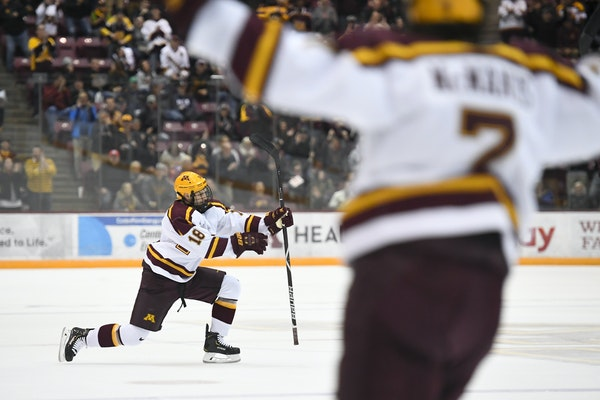 Gophers defenseman Clayton Phillips and forward Brannon McManus celebrated McManus' second goal against Minnesota Duluth. They have had to adjust to