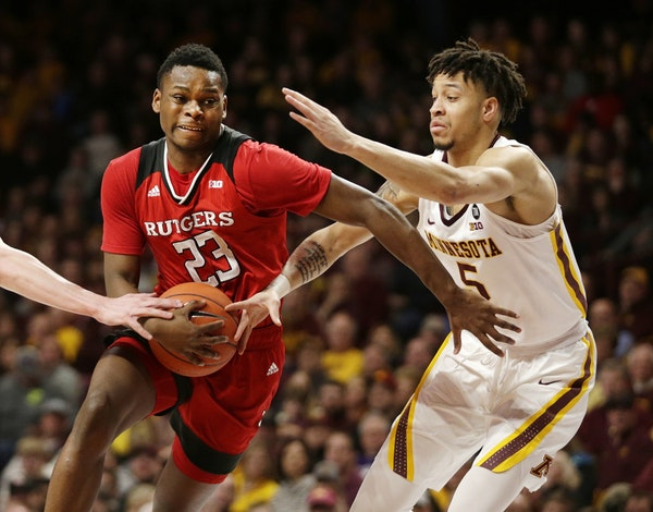 Rutgers guard Montez Mathis drives on Minnesota guard Amir Coffey during the second half Saturday in Minneapolis. The Gophers defeated Rutgers 88-70.