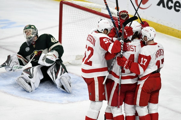 Teammates mobbed Detroit's Tyler Bertuzzi after he completed his hat trick against Devan Dubnyk and the Wild.
