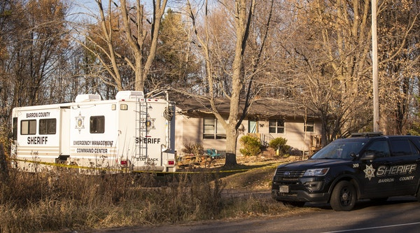 The home of James and Denise Closs in Barron, Wis. is seen with Barron County Sheriff vehicles parked outside in October 2018.