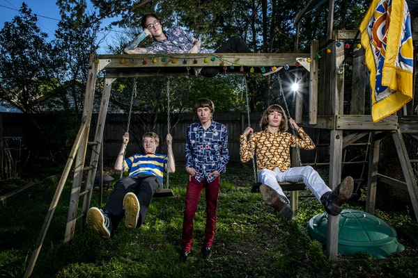 Roman and Royce Mars, center and right, are the swinging set of siblings behind the Carnegies with bandmates Owen Hiber, left, and Brandon Cox.