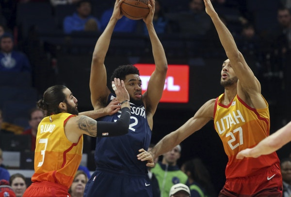 Wolves center Karl-Anthony Towns tried to beat the double-team of Utah's Ricky Rubio, left, and Rudy Gobert in the first half Sunday.
