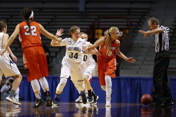 Players looked on as an official made an out-of-bounds call during the 2017 state girls' basketball tournament.