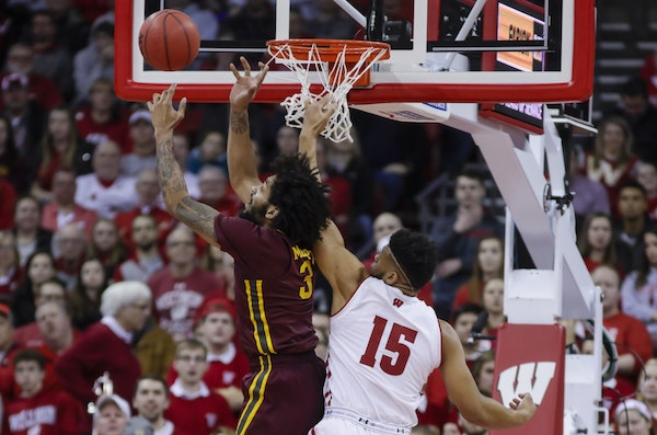 Minnesota's Jordan Murphy (3) goes after a defensive rebound against Wisconsin's Charles Thomas (15) during the first half of an NCAA college basketba
