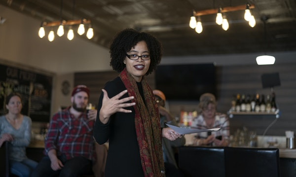 Sagirah Shahid read poetry at Sisters' Sludge Cafe during an event hosted by the Standish-Ericsson Neighborhood Association.