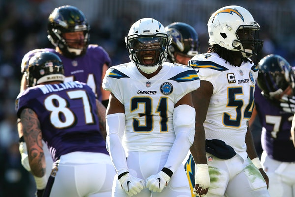 Adrian Phillips (31) — one of seven defensive backs the Chargers used for much of Sunday's wild-card game at Baltimore — reacted after a first-hal