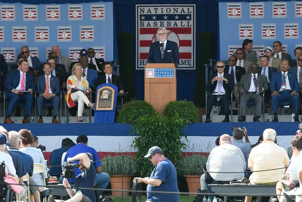 2018 Baseball Hall of Fame inductee Jack Morris, top center, speaks during the induction ceremony in Cooperstown, NY. Members of the Hall are voted in