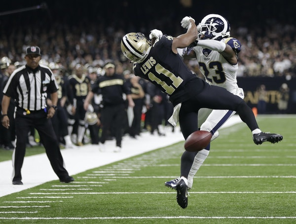 Saints wide receiver Tommylee Lewis looked for a call after getting hit by Rams defensive back Nickell Robey-Coleman. Lewis didn't get one.