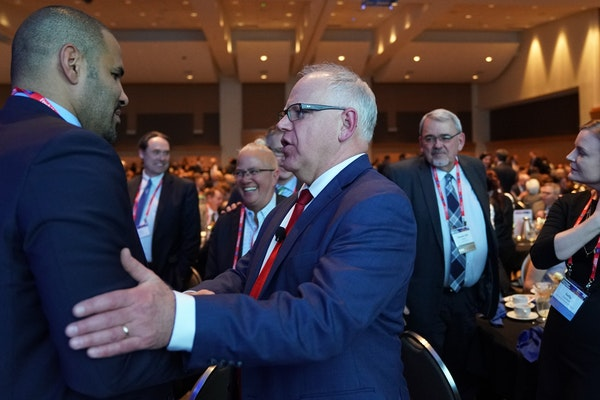 Gov. Tim Walz spoke with Tony Sanneh of the Sanneh Foundation during the Minnesota Chamber of Commerce's annual policy kickoff event Wednesday.