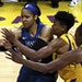 Maya Moore, left, fights for the loose ball against the Los Angeles Sparks' Alana Beard, middle, Nneka Ogwumike during the game that eliminated the Ly