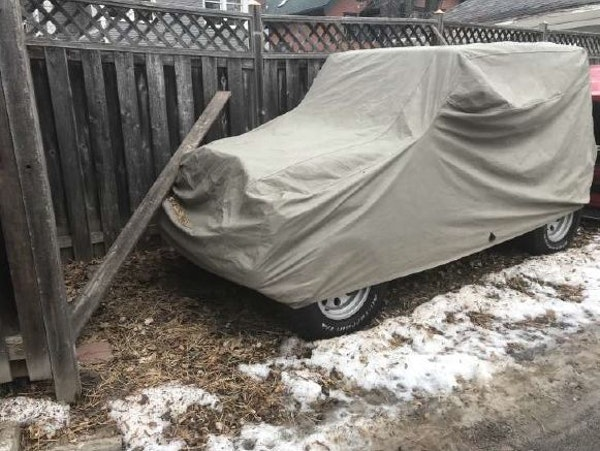 """A city inspector took this photo of a vehicle parked on Rep. John Lesch's property. He was cited in December for two vehicles being parked on an """""""