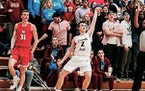 Lakeville South guard Reid Patterson followed through on a successful three-pointer in a victory over Lakeville North on Friday.