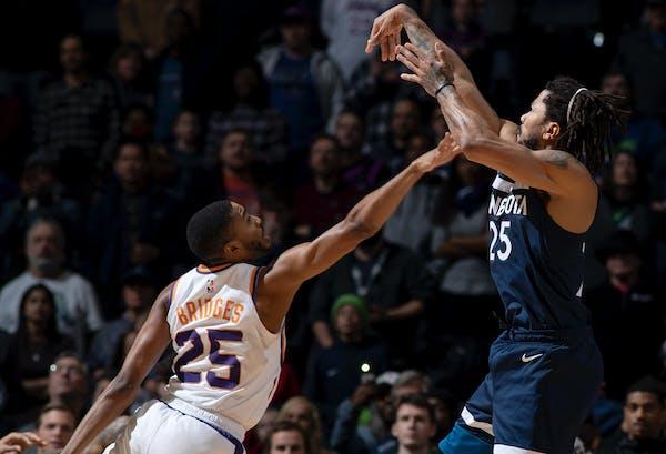 Derrick Rose took the winning jumper over the Suns' Mikal Bridges on Sunday night at Target Center. ] CARLOS GONZALEZ • cgonzalez@startribune.com �