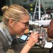 Optometrist Dr. Meredith Walburg examines Denae Whitfield's eyes at Harding High School. Whitfield is one of 2,500 St. Paul Public Schools students
